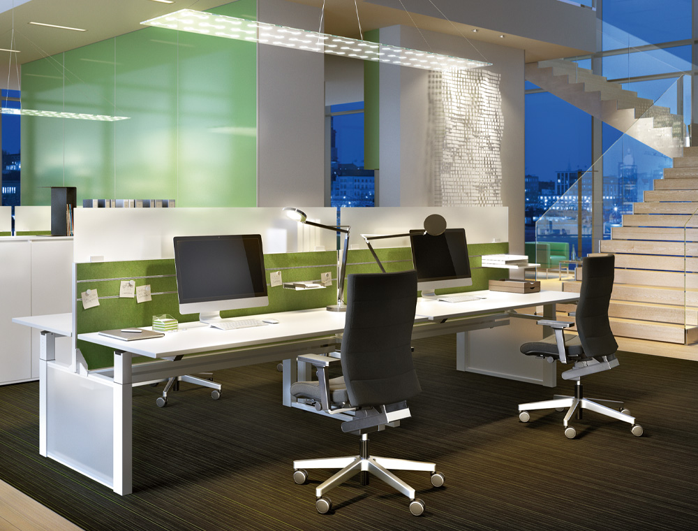 Side and rear view of the stylish, high CHAMP swivel armchair in grey in a modern working environment.