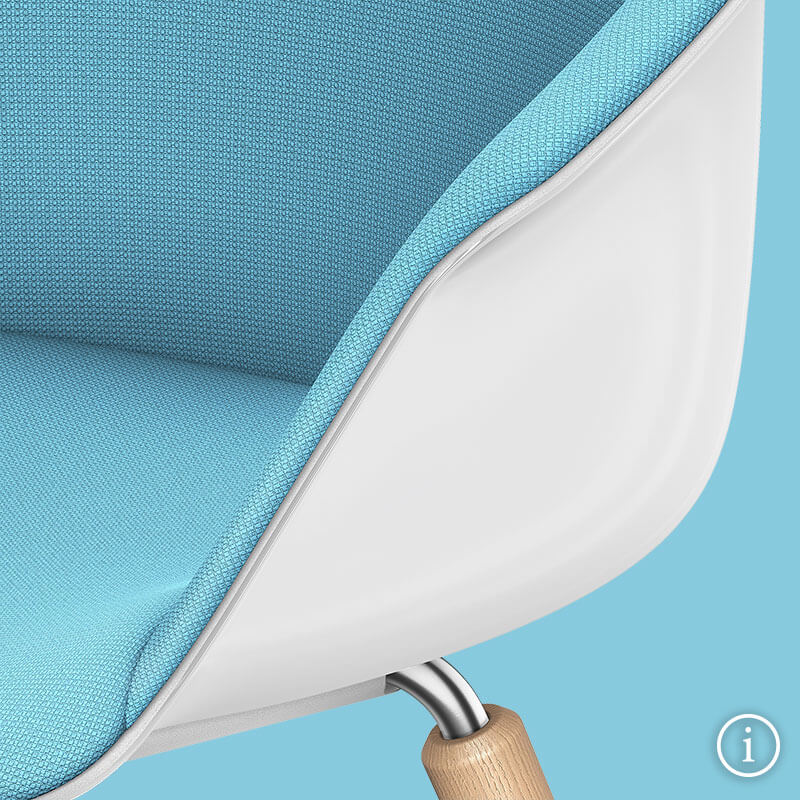 A front view close-up of the SHUFFLEis1 lounge chair with a white plastic shell, fully upholstered in blue and a part of the wooden leg on a blue background. Further information is available via the information button at the bottom right | by Interstuhl